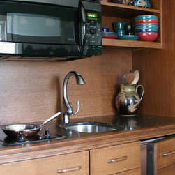 Compact Kitchen can cook anything! - Here is a closeup of a hardworking, quartersawn oak primary kitchen.  It was originally sent to Maryland, but now resides in Cocoa Beach Florida. GE's Advantium oven is a key to making it a kitchen that can cook anything. With Convection cooking, speed cooking, microwave and warming functions, it is more versatile than most ovens twice its size.