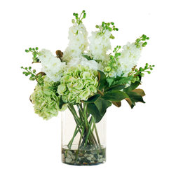 Winward Home - Hydrangea and Delphinium in Glass - A standard in English cottage gardens, the delphinium is a stately, elegant perennial enjoyed for their showy spikes of colorful summer flowers. Mixed in with Winward's signature hydrangea and magnolia leaves, this summer bouquet is thrown into a bed of rocks for an appealing visual balance.