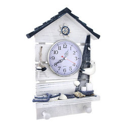 Whitewashed Nautical Boat House Wall Clock with Pegs - This boat house wall clock complements beach or nautical decor, beautifully! Made of wood, it measures 12 3/4 inches tall, 9 inches wide, 2 inches deep and has a 4 1/4 inch diameter clock face. This piece is decorated with all things nautical, from netting and seashells to a row boat and bobbers, and it has 2 pegs for hanging up keys or other small items. The clock features quartz movement, has easy to read black numbers on a white background, and runs on 1 AA battery (not included). It easily mounts to the wall with 2 nails or screws by the hangers on the back, and it is a lovely accent anywhere in your home.