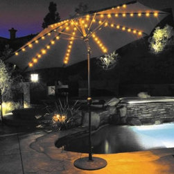"Galtech 9-ft. Aluminum Auto Tilt Patio Umbrella with Umbrella Lights - A lighted umbrella simply makes a gathering more festive. You'll enjoy many relaxing get togethers for years to come with the 9 foot Aluminum Auto Tilt with Lights. It brightens any night with its built in LED lighting system. The low voltage lighting package lets you enjoy your umbrella during the night with pleasant illumination. A switch on the housing operates the lights, and a 20-foot cord plugs in to any grounded outlet. The LED lights have been tested and will provide 15,000 hours of use. During the day, the auto tilt feature will provide maximum shade. Choose a winning combination from two pole choices, three fabrics, and over two dozen shade colors.This umbrella also features a solid resin hub, push button coupling and plastic housing for durability and ease. Choose our value-priced Suncrylic fabric, which comes with a 1-year warranty against fading, or choose our top-quality Sunbrella, now with many more colors and textures and a 5-year warranty against fading. About SunbrellaSunbrella has been the leader in performance fabrics for over 45 years. Impeccable quality, sophisticated styling and best-in-class warranties prove the new generation of Sunbrella offers more possibilities than ever. Sunbrella fabrics are breathable and water-repellant. If kept dry, they will not support the growth of mildew as natural fibers will. Beautiful and durable, Sunbrella is a name you can trust in your outdoor furniture. Cleaning and Caring for SunbrellaRegular maintenance is the best way to keep your Sunbrella fabrics looking good and delay deep, vigorous cleaning. Brush off dirt before it becomes embedded in the fabrics, and wipe up spills as soon as they occur. For light cleaning, use a mild soap and water solution and a sponge, allowing your cleaning solution to soak into the fabric. Rinse thoroughly to remove all soap residue and allow fabric to air dry. Sunbrella fabrics have been tested to provide up to 98% UV protection, depending on depth of color. Whites and lighter colored fabrics provide less protection than darker fabrics. This protective factor is inherent to the product and will not diminish through use or exposure to the sun. Sunbrella furniture and umbrella fabrics have been awarded the """"Seal of Recommendation"""" by the Skin Cancer Foundation, an international organization dedicated to the prevention of skin cancer. Beautiful and protective fabric is the hallmark of Sunbrella. We're now proud to offer Sunbrella A and B fabric choices - our A line includes beautiful stripes and textures, including a linen-like feel and look. Nothing beats Sunbrella when it comes to outdoor quality and style."