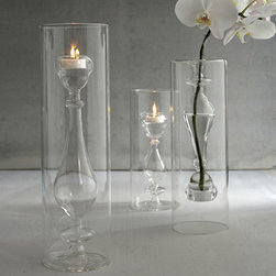 Light Opera Set of 3 Candlestick Tealight by Two's Company® - I love pieces that multifunction. This hand blown glass vase accommodates a tealight, protects it from the wind, and can serve as a vase when you are not lighting it up.