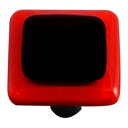 "Aquila Art Glass - Brick Red Border Black Knob. Alum Post - To make our cabinet knobs and pulls, 2 to 5 pieces of glass are cut, cleaned, stacked together and placed into a kiln. The kiln goes up to 1450 degrees Fahrenheit, the glass becomes molten and fuses together to make one piece of glass. The glass is then cut out out to the required shape. Next the glass is placed back into a kiln and taken to 1300 degrees fahrenheit and the edges are ""fire polished"". The glass spends about 48 hours in the kilns. Expect slight variations in color & size."