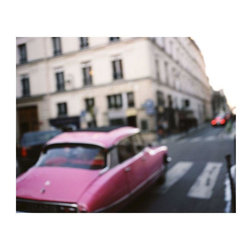 """Pink Car - Paris, France"" Floating Photo Print - Ring the alarm! We spot a retro Chairish pink car and we're climbing into our time machine stat to grab these wheels for ourselves! Ok, maybe not, but this print by Jessica Wilson is definitely transporting us to another time and place. 1/4 inch thick museum grade archival acrylic was used to face mount this beautiful floating frame. All materials used are 100% archival museum grade."