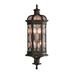 Fine Art Lamps - Devonshire Outdoor Coupe, 414981ST - Large wall mount coupe in antiqued bronze finish with subtle gold accents and acanthus leaf motif. Features textured seedy glass panes. 60 watt B-10 bulb, candelabra base light bulb. UL Listed, porcelain socket. Bulb(s) not included. We recommend that all Fine Art Lamps are hung by a professional electrician. All fixtures come with specific hanging instructions and descriptions. Contact Houzz for specific questions regarding installation instructions