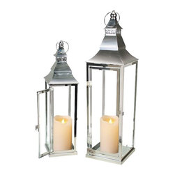 """Asian Import - Silver Stainless Steel Lanterns with Motion Flame Moving Wick Candles - These stunning polished stainless steel candle lanterns feature Asian inspired pagoda style hoods with clear glass panes and hinged doors. The traditional styling, inspired by those used in Grand European Hotels in the golden age, were often found in luxury homes, vacation homes and upscale restaurants of that time. The Palm Beach Silver lanterns are beautifully finished and polished like silver. The lanterns are 5.25""""W x 5.25""""D x 20""""H and 7""""W x 7""""D x 26"""" high."""