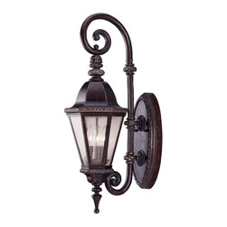 Canterbury Wall Mount Lantern - Royal and Stately in a Bark and Gold finish with Clear Seeded glass. Weight: 21. 00 lbsFinish: Bark & GoldBulb Wattage: 40Glass: Clear SeededNumber of Bulbs: 3Candle Covers: Bark & Gold MetalType of Bulb: CExtends Length: 13. 00Bulbs Included: NoBackplate Width: 7. 00Backplate Height: 14. 00Safety Rating: UL, CULUL Wet/Damp Location: UL Wet LocationVoltage: 120