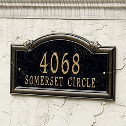 Ballard Designs - Somerset Arch Two Line Wall Address Sign - Made in the USA. Choose One Line or Two Line design. Available in wall mount or in-ground installation style. Make your address the nicest one on the block. It's crafted of cast aluminum with weather-resistant paint to last the life of your home. Antique gold lettering with black background. For One Line: Up to 5 numbers/spaces; for Two Line: Up to 5 numbers/spaces for top line and up to 16 characters/spaces for bottom line.Somerset Arch Address Sign features:. . . *Please note that personalized items are non-returnable.