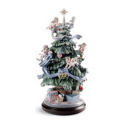 """Lladro Porcelain - Lladro Great Christmas Tree Figurine - Plus One Year Accidental Breakage Replace - """"Hand Made In Valencia Spain - Sculpted By: Virginia Gonzalez - Limited To: 2000 Pieces Worldwide - Included with this sculpture is replacement insurance against accidental breakage. The replacement insurance is valid for one year from the date of purchase and covers 100% of the cost to replace this sculpture (shipping not included). However once the sculpture retires or is no longer being made, the breakage coverage ends as the piece can no longer be replaced. """""""