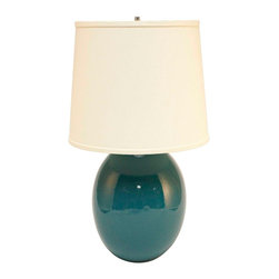 "Haeger Potteries - Asian Haeger Potteries Ocean Blue Ceramic Egg Table Lamp - Haeger's famous glazes are the result of over four generations of development by expert craftsmen. This timeless table lamp features a ocean blue glaze over an egg shaped ceramic base. The shade is made of cream linen fabric. High fired gloss ocean blue finish. Ceramic lamp base. Cream linen shade. Takes one 150 watt or equivalent bulb (not included). 24"" high. Shade is 13"" across the bottom 11"" across the top and 11"" high.  High fired gloss ocean blue finish.  Ceramic lamp base.  Cream linen shade.  Made in USA.  Takes one 150 watt or equivalent bulb (not included).  24"" high.  Shade is 13"" across the bottom 11"" across the top and 11"" high."