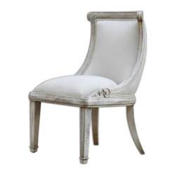 Uttermost - Anesio Armless Chair - Curved, carved and padded for comfort, this solid mango wood chair comes in a beautiful antique bone finish. You've wanted to add some Mediterranean panache to your dining room and this armless chair is just the thing to get to you Old World glamour town.