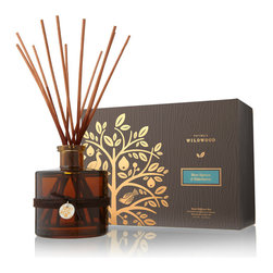 Blue Spruce & Elderberry Reed Diffuser - 7.75 oz - Revitalize a room with the subtle constant aroma offered by the Blue Spruce and Elderberry Reed Diffuser.  A glass bottle in dark honeyed brown handsomely complements the smoky undertones in this fresh, green, remarkably crisp aroma of evergreen trees and woodland growth.  Herbaceous and elaborated by hints of spice, the aromatic home fragrance is sophisticated and alive.