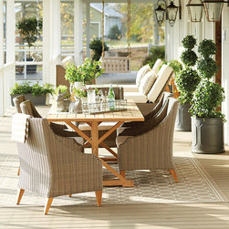 Ballard Designs - Sutton 7-Piece Dining Set - Includes Dining Table & 6 Dining Arm Chairs. Table patina will mellow to warm silvery gray if left untreated. Chairs have tapered teak feet & come fully assembled. Off-White outdoor cushions included. Our Sutton 7-Piece Dining Set takes weekends very seriously. Table is crafted of heavy reclaimed teak to be naturally strong and resistant to moisture and damaging insects. Chairs have strong, rustproof aluminum frames wrapped in all-weather rattan to resist fading, mildew and moisture. Each strand has multiple shades of warm tan, gray and mocha to create the warm Weathered Driftwood finish. Sutton Outdoor Dining Set features: . . . .
