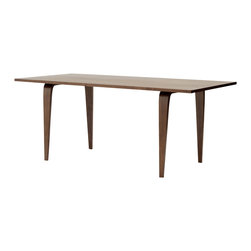 "Cherner - Cherner Rectangle Table - The Cherner Rectangle Table, made from molded plywood in the USA, was designed to complement Cherner chairs. Lightweight and strong, the Cherner Rectangle Table's top is 1.125"" thick. Table is 29.5"" h x 72-80"" l x 34"" w"