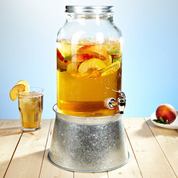 Mason Jar Beverage Dispenser With Party Tub - A drink dispenser is a must for outdoor parties so that you can relax and let your guests help themselves. Set up a couple with kid-friendly drinks to give parents a break from having to get up and refill their kids' cups every 10 minutes — they will thank you! The steel base of this neat Mason jar dispenser doubles as a beverage tub that can chill cups in ice or keep bottles cold.