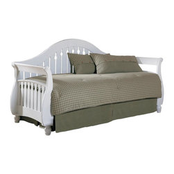 Leggett/Platt Fashion Bed - Fraser Daybed w Link Spring in Frost - The Fraser daybed features a substantial frame with keyhole slatting wrapping across the sides and back. Posts are styled with sleigh curves that complement the traditional camelback crest. Optional trundle sold separately will allow for bonus sleeping space. Made of Poplar & MDF. Available in the following finishes: Distress Blacked and White. Pictured in White. Link Spring included. 41 1/8 in. W x 89 3/8 in. L x 49 1/2 in. HThe design of the Fraser daybed is simplicity itself. The back has a curved camel back and the arms curve out, as if inviting you inside. The back and arms comprised of 3 5/8 in. wood slats set one inch apart with a keyhole pattern carved in the center slats of the back and all the slats of the arms. The front of the arms bow out at the bottom and end in delicately carved feet. The Fraser is made of Poplar wood and comes in two finishes, Walnut and Frost (white). It is a really versatile piece of furniture to go with many decors, suitable for both seating and sleeping.