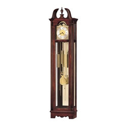Howard Miller - Howard Miller - Nottingham Floor Clock - Enjoy the trappings of the classic grandfather clock experience with an Egyptian edge in this stunningly crafted and designed cherry floor clock featuring polished brass pendulum and quartz dual chime with night silences. * This floor clock features an elegant swan neck pediment with a turned, urn finial and a shell embossing. . The polished brass finished dial offers an ornate, gold tone center and a silver tone chapter ring. A simulated, midnight blue moon phase accents the dial. . An illuminated case and glass mirrored back and base highlight the polished brass pendulum. . Brass plate available for an additional charge. . Quartz, dual chime movement plays Westminster or Ave Maria chimes, and features volume control and automatic nighttime chime shut-off option. . Finished in Windsor Cherry on select hardwoods and veneers. . Cabinet is illuminated by an interior light. . Automatic nighttime chime shut-off option. . Manufacturer's 2 Year Warranty. 77 1/4 in. (196 cm) H x 18 1/2 in. (47 cm) W x 10 1/4 in. (26 cm) D