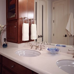 Bathroom countertops featured in Corian® Whisper. - Photo by Dupont