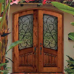 GlassCraft's Knotty Alder wood door with Bellagio wrought iron - GlassCraft Door Company's Knotty Alder wood door in Arch Lite, double door configuration. Shown with Bellagio wrought iron grille. The wrought iron grille comes in 3 color options: Antique Black, Antique Bronze and Antique Pewter.