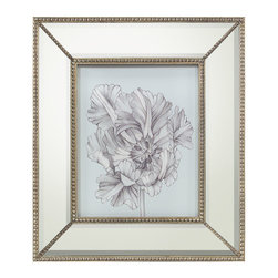 Silvery Blue Tulips I Print with Mirrored Frame - Influenced by the luxurious botanical prints gracing the garden rooms of English country manses, the artwork presents a quiet blue background that introduces an intricate illustration of a magnificent bloom rendered in whispers of gray. The wide mirrored frame accented with petite beading in the bevel and each corner lends a touch of refined glamour to the Silvery Blue Tulips I artwork.