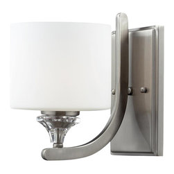 One Light Brushed Nickel Matte White Glass Bathroom Sconce - Using a satin nickel finish and a matte white shade, this wall sconce creates a clean, sophisticated look. Crystal adornments shimmer and compliment the clean look of this fixture.