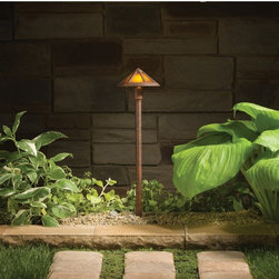 Kichler - Kichler Woods 15450TZT Landscape 12V Path and Spread - 6 in. - Textured Tannery - Shop for Lighting from Hayneedle.com! Transform the ambience in your outdoor space with the Kichler Woods 15450TZT Landscape 12V Path and Spread - 6 in. - Textured Tannery Bronze. Use it to illuminate pathways or walkways in your space making sure they re safe to walk on in the dark. Made for outdoor use its aluminum construction keeps it protected against the elements. It accommodates two bulbs which suffuse your space with brilliant radiance. With a sleek frame it features an elegant shade and attractive finish.Kichler QualitySince 1938 Cleveland-based Kichler Lighting has been known for their innovative designs and excellent craftsmanship. Kichler is the world's leading decorative lighting fixture company and the winner of four ARTS Lighting Manufacturer of the Year awards. Kichler designers travel the world to discover the latest trends in exterior and interior style colors and designs. They then translate the best of those trends into fixtures that will bring beauty pleasure and light into your home. Kichler fixtures stand the test of time and are functional works of art that you're sure to treasure.