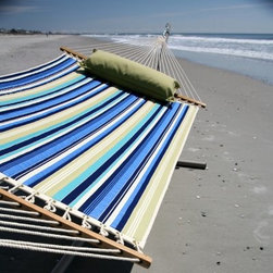 Pawleys Island Beaches Quilted Duracord Fabric Hammock - Additional features Overall hammock length: 13 ft. Polyester fiberfill batting Weather-resistant DuraCord rope The beach-inspired Pawleys Island Beaches Quilted Fabric Hammock is specifically designed with Duracord fabric which offers resistance to fading mildew and stains. These soft and supple fabrics are quilted together around a thin polyester fiberfill batting that provides maximum comfort. Solid oak spreader bars are hand-dipped with multiple coats of weather-resistant marine varnish. You'll love relaxing in this hammock and enjoying the coordinating stripes of blue and citron as well as a natural stripe reminiscent of pearly sand beaches. How does DuraCord differ from other fabrics? DuraCord is a hybrid fiber due to the many alterations that are made to its base ingredient. It is manufactured in a much smaller denier size meaning individual fibers are smaller making more fibers per yarn. The fibers go through a special texturizing process to give it its soft-to-the-touch cotton-like feel. Fibers are de-lustered to take away the shiny look of the yarn and give it a cotton-like look. DuraCord fabrics are abrasion resistant easy to clean stain resistant color fast fade resistant and have 1 000+ hours of UV resistance. The DuraCord fibers have the properties to make them durable for long outdoor life but without the synthetic feel. About Pawleys IslandIn 1889 the Original Pawleys Island Rope Hammock was created at Pawleys Island one of the oldest summer resorts on the South Carolina coast. When river boat pilot Captain Joshua John Ward found the grass-filled mattresses on his boat too hot in the summer he decided to make a cool and comfortable cotton rope hammock to use on his boat. After several uncomfortable designs Cap'n Josh made a hammock using wooden spreaders without knots. This original design has proven to be so comfortable that it's still used in Pawleys Island's popular hammocks over a century later. Pawleys Island continues to use the highest-quality materials when making its traditional all-cotton rope spun polyester rope and DuraCord hammocks. The custom-designed stretcher bars are cut from seasoned Carolina red oak then steamed bent drilled sanded and varnished to impart a comfortable sway to the hammock and to spread the rope evenly for optimum stability. The people of The Original Pawleys Island Rope Hammock are incredibly proud to be anything but new-fangled. Now 120 years old and counting they continue to offer the very best of their past hoping it will help you better enjoy your future.