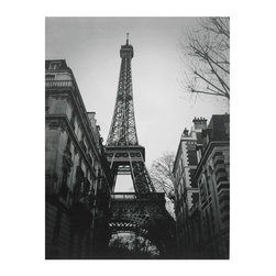 Oriental Furniture - Eiffel Tower Sun Glow Canvas Wall Art - A black and white image of the iconic Eiffel Tower, as seen from among old Parisian buildings. The aged buildings, bare-branched trees and high contrast of the print give this wall art a vintage European feel. Perfect for a touch of old Europe in the living room, office or bedroom.