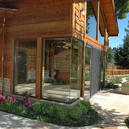 Marvin Windows and Doors - Marvin Bronze Clad Exterior, Bare Pine Interior Windows.  The center window is Clad Polygon Rectangle in a ninety degree corner configuration. by Old Town Glass, Inc.