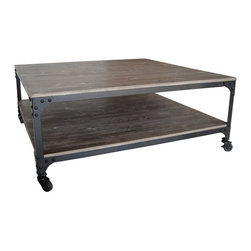 INDUSTRIAL COFFEE TABLE - This could possibly be the perfect coffee table. With a storage solution built in, this table will fit nicely in your industrial inspired loft. With an additional level to store your magazines and remote controls, the surface is free for drinks or a relaxing dinner in front of the TV. Not only that, but the black metal frame contrasts attractively with the distressed wood surface and comes on castors for easy mobility.