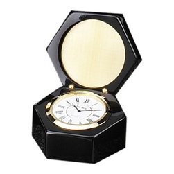 """Brass Desktop Quartz Clock in Case - The brass desktop clock in case measures 4""""H x 3.25""""Dia. This beautiful desktop clock is an ideal addition to any executives desk. The display case is polished and is very eye catching. This clock makes a great gift and wonderful display item."""