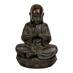 "Oriental Unlimited - 16 in. Tall Sitting Japanese Zen Monk Statue - A simple, beautiful work of timeless art, cast from fine quality heavy resin. Wonderful detail; serene face, shaved head, long earlobes,""Namaste"" mudra. Provides unique and distinctive decorative Asian accent. A meditating Zen Buddhist monk, possibly a young novitiate. Beautiful cast resin reproduction of a Japanese style bronze. 11 in. W x 11 in. D x 16 in. HBuddhism came late to Japan and the Japanese developed a uniquely simple, beautiful, natural teaching; Zen. Our distinctive monk statues can add an element of that same natural simplicity and beauty to your home or office decor."