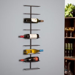 """Oenophilia Wine Ledge 9-Bottle Wall Wine Rack - Let your wine speak for itself displayed cleanly on the Oenophilia Wine Ledge 9-Bottle Wall Wine Rack. Minimalist design shows off your colorful labels creating a bright simple work of art. No wonder it's a best-seller. All bottles aim the same direction - we hope they point the way to the corkscrew! About OenophiliaWith a name Greek in origin meaning """"""""the love of wine """""""" Oenophilia delights in fulfilling its mission to bring together products that allow others to love wine with the passion that Oenophilia does. After creating their first product in 1983 the Oenophilia team has continued to produce and manufacture superior wine accessories and is known as one of the leading wholesale suppliers of wine accessories and gifts in the U.S. Although located in Hillsborough NC traveling the world has allowed Oenophilia to provide customers with a premium extensive collection of wine accessories including openers wine racks glassware and gifts. Oenophilia carries their signature line of original designs and packaging as well as exceptional brands such as Vacu-Vin Metrokane Rogar Srewpull and Spiegelau. Bringing eclectic wine products competitive pricing and responsive customer service to the table is the Oenophilia team's way of sharing their passion while achieving their goal of providing customers with a luxurious one-stop shopping experience."""
