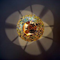 Fabulous Lighting Fixtures - The oval shape on this pendant light is accented by the abalone coins embedded into the glass shade, and with the open top and bottom, its casts intriguing patterns on the ceiling. Photo: Tony Cossentino, Why the Foto