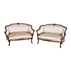n/a - Consigned  French Walnut Settees, C. 1870, Pair - Pair of elaborately carved walnut settees, constructed out of European walnut and upholstered in light cream color satin. Dated to 1870s, attributed to Parisian school. Settees are standing on foliate-carved legs. They feature a foliate-carved top rail and the front rail features a shell motif. Back is divided into three sections.