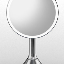 Lighted Makeup Vanity Mirror - All makeup mirrors are not created equally. This magnification mirror lights up automatically as your face approaches. It comes with LED lights that simulate sunlight and won't burn out or diminish, even after many years. Plus, it's cordless!