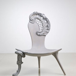 Rococo Chair - If chairs could dance, this one would probably be center stage. I think it's the perfect piece to place in modern room as a foil to all of the other furniture. And did you notice the three legs?