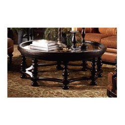 Tommy Bahama Home - Round Plantation Cocktail Table w Spool Legs - True Glass top. Recessed woven panel. Made from mahogany solids, American maple and mahogany veneers. Tamarind - black, highly distressed finish. Minimal assembly required. 55 in. Diameter x 20 in. H (180 lbs.). Special Care Instructions from Lexington FurnitureKingstown is a relaxed traditional collection inspired by British Colonial style, with a hint of Campaign and a touch of safari. The Tamarind finish is a rich aged black with rub-through to crimson and gold undertones beneath. The evocative designs provide a sense of a well-traveled life.of items hand selected during journeys around the globe. Each piece is crafted as a one-of-a-kind find yet the eclectic collection coordinates beautifully. Travel the world without ever leaving home.