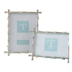 Set of 2 Bamboo Photo Frames - 4 x 6 and 5 x 7 - A sleek, updated feel is conveyed by the Bamboo Photo Frames, which replicate the texture and the delicately interrupted lines of a timeless and exotic decorative material in the bright luxury of silver metal. Sold as a set of two common sizes, the frames mix the casual with formal for upscale style anywhere from an urban townhouse to a far-off, all-natural vacation home.