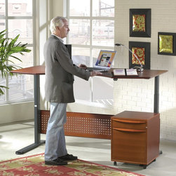 Jesper - Jesper Sit and Stand Height Adjustable Desk - Cherry Multicolor - 7190105-CH - Shop for Desks from Hayneedle.com! On a busy day you don't always have time to get up to stretch or take a stroll to the office coffee machine but you're sure to want to at some point right? Sitting in one place for extended periods of time can make you stiff sore and - let's face it - cranky. That's why the Sit and Stand Height Adjustable Desk - Cherry is designed to work for your body as you're working through the day. Motorized legs lift the desktop from a seated height to a standing height any time you feel the need to limber up. This warm and inviting computer desk is crafted from durable wood veneers and engineered wood with solid wood edging - as well as a recessed perforated wood modesty panel - finished in a warm cherry shade. The spacious desktop is ergonomically curved to provide the best arm support while you're working at a computer or laptop. Below motorized steel legs finished in an Anthracite black move from 25H inches to 52H inches with a quick push of a button. Alternating between sitting and standing positions while working can reduce the discomfort and possible injuries caused by staying in a stationary position for long periods of time. An optional included storage unit fits neatly below the desktop on either side. Two drawers - a small supplies drawer at the top and a larger file drawer beneath - offer space to discreetly lock away papers folders staplers and other office essentials. Three sizes are available to fit into offices and rooms of all sizes and a 10-year manufacturer's warranty is included. Available Sizes: 47W x 36D x 25-52H inches 63W x 39D x 25-52H inches 75W x 41D x 25-52H inches
