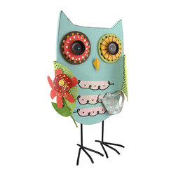 Whimsical Wooden Gardening Owl with Tin Accents - Add an adorable accent to any table or plant stand in your home or on your porch or patio with this gardening owl statue. Made of wood, with tin accents, it measures 13 inches tall, 7 3/4 inches wide, and 3 1/2 inches deep. It is hand painted in cheerful colors, and the owl is holding a springy flower in one wing, a watering can in the other. This piece makes a great gift for your favorite gardener, or for a friend that collects cute owls.