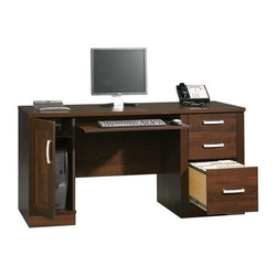 Sauder - Office Port Computer Credenza in Abbey Oak Fi - Slide-out keyboard and mouse shelf. 2 Small drawers feature metal runners and safety stops. Lower drawer with full extension slides hold letter, legal or European size hanging files. Storage area behind door holds vertical CPU tower and has an adjustable shelf. Durable melamine top is heat, stain and scratch resistant. Grommet hole for cord management. Patented T-lock drawer system and patented slide-on moldings. Made of engineered wood. Assembly required. 59 in. W x 23 in. D x 29 in. H. Optional hutch: 59 in. W x 16 in. D x 47 in. H