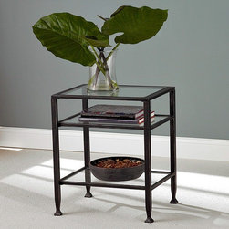 Holly & Martin - Holly & Martin Guthrie Metal End Table - Legs of a slightly antiqued look rise from gently fluted feet to hold three shelves of glass in this end table. Flattering to practically any d̩cor particularly when matched with its partner cocktail and sofa tables. * A sleek table with a contemporary design, this table will take your living room to a new level of style. This table with glass surface and shelve framed in black metal give you an amazing look that will match with a wide variety of sofas and chairs. Assembly: Required. Material of construction: Rectangular metal tube, 5 mm Tempered clear glass. 16 in. W x 24 in. H x 20 in. D