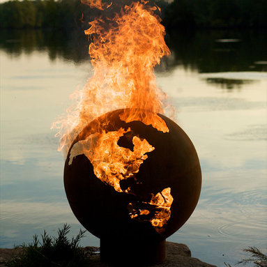 """Fire Pits - Great for Fall and Winter - The Third Rock Fire Pit's large orb is relieved of the earth features and promotes the watery two thirds of our planet in steel. When afire this design highlights the earths fiery inner core. This original design is made to order by Tennessee craftsman in the heartland of America. They are constructed from heavy duty 1/4"""" thick mild carbon steel and are the most durable steel fire pit made anywhere. The inner bowl has a high temperature resistant coating and comes with a 1 1/2"""" diameter rain drain.  The outer iron oxide patina is maintenance free and the fire pit can be left outside in all weather conditions. Over time and use the patina will mature and darken a few shades and then remain permanent forever. Each unique fire pit is individually numbered by the artist on an attached brass plaque."""