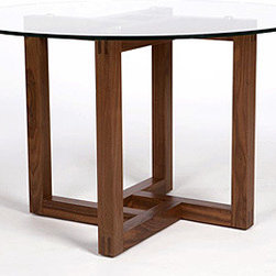 "Canto Pedestal Table - The Canto pedestal table has a 48"" top, allowing it to fit into smaller spaces, such as condo dining rooms or breakfast areas in larger kitchens. The rotating, interwoven pattern of the solid wood base creates an interesting visual focal point, and the choice of either a glass top or a veneered top (both square or round) allows for design flexibility."