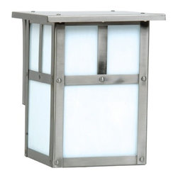 Craftmade Lighting - Mission Style Outdoor Wall Light with Frosted White Glass - Z1842-56 - The Mission Collection from Craftmade Lighting brings a line of simply designed outdoor lighting fixtures that can successfully add a modest and genuine dynamic to your home�s profile. The down-to-earth design of this 1-light outdoor wall-mounted fixture also reflects that style. The milk white frosted glass shade and the beautiful stainless steel finish add instant beauty and ambience to your outdoor places. With dimensions of 6-inch width by 7-1/2-inch height, this wall light is sure to garner attention of the onlookers. Takes (1) 60-watt incandescent A19 bulb(s). Bulb(s) sold separately. ETL listed. Wet location rated.