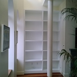 "Custom Bookcase Unit New York, NY - After consultation with our clients and designer, we created a 10' tall and almost 70"" wide bookcase unit. This built-in unit consisted of 2 sections and each having 5 shelves. The material that was used was MDF with satin white lacquer finish."
