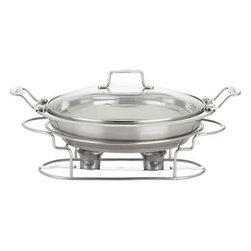 Scanpan® Chafing Dish - Entertain in style with this standout chafing dish, finely crafted in polished stainless with fully tempered glass lid. Encapsulated aluminum base allows the versatility of cooking directly in the warming dish on any cooking surface, including induction, or independently with the use of two tealights, fondue/chafing gel or Sterno canned heat. Chafing dish features the same upscale Danish design, eco-conscious construction, and professional lifetime performance as Scanpan's acclaimed cookware.