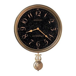 HOWARD MILLER - Howard Miller Paris Night Moment In Time Pendulum Wall Clock - This Moment in Time dial is elegantly framed in an antique brass bezel,while a decorative antique brass pendulum swings below.