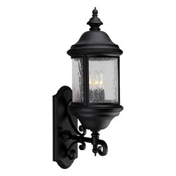 Progress Lighting - Progress Lighting Ashmore Traditional Outdoor Wall Sconce X-13-2565P - This Progress Lighting Ashmore Traditional Outdoor Wall Sconce is a classic piece with timeless elegance. It has a magnificent frame in a textured black finish with curvaceous scrolls, top and bottom finials and panels of water seeded glass. It's a beautiful and elegant, three-light fixture that's inspired by lanterns from the Old World.