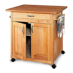 "Catskill Craftsmen - The Big Island Kitchen Cart - The Big Island kitchen cart provides and amazing 7 1/2 square feet of work-top space. The cabinet doors conveniently open from both sides, making the Big Island extremely functional from either direction. A large, full extension drawer gives even more storage space for any kitchen. This island is both functional and attractive. The big kitchen island also features four locking caster wheels for mobility when you want it and a sturdy cutting surface when you need it. The oil finish seals and protects the beauty of the North American hardwood. Features: -Constructed from North American hardwood and hardwood veneers. -Solid hardwood top. -Natural oil finish. -One large, full-extension drawer. -Storage cabinet with doors on both sides and adjustable shelving. -Two towel bars. -Decorative silver handles. -Locking casters. -Overall dimensions: 34.5"" H x 38"" W x 30"" D."